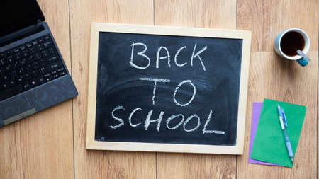 welcome desk: Back to school written on a chalkboard at the office