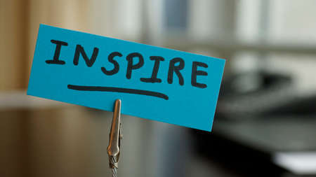 novelist: Inspire written on a memo at the office Stock Photo
