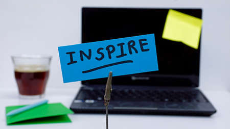 Inspire written on a memo at the office photo