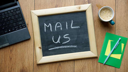 write us: Mail us written on a chalkboard at the office