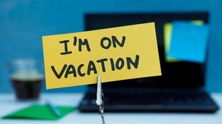 I am on vacation written on a memo at the office