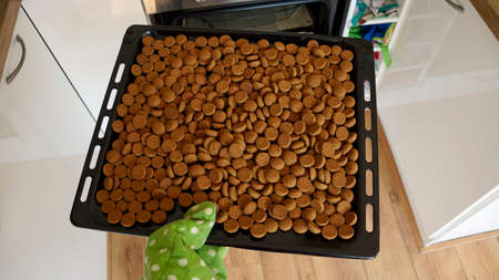 '5 december': Pile of Pepernoten on a scale, typical Dutch treat for Sinterklaas on 5 december