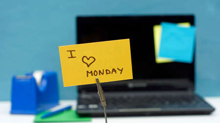 hand job: I love monday written on a memo at the office Stock Photo