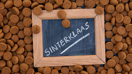 5 december: Pile of Pepernoten on a plate, typical Dutch treat for Sinterklaas on 5 december Stock Photo