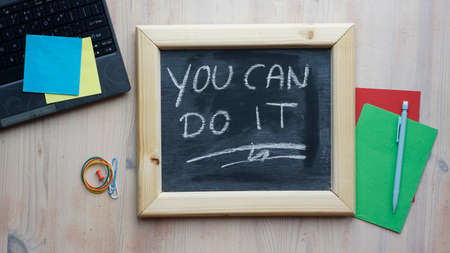 You can do it written on a chalkboard at the office photo