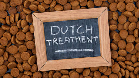 festiveness: Dutch treatment written on a chalkboard between dutch gingerbread