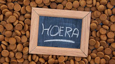 festiveness: Hurray in Dutch is written on a chalkboard between Dutch gingerbread