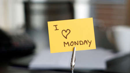 I love monday written a card at the desk photo