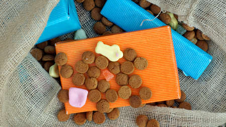 festiveness: Pile of Pepernoten and presents, typical Dutch treat for Sinterklaas on 5 december