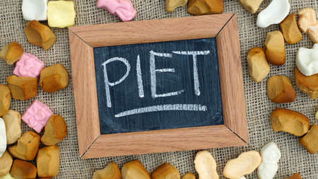 festiveness: A chalkboard with the text Piet and a pile of Pepernoten, typical Dutch treat for Sinterklaas on 5 december