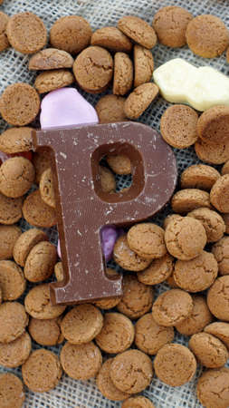 '5 december': Pile of Dutch Pepernoten and chocolate, typical Dutch treat for Sinterklaas on 5 december