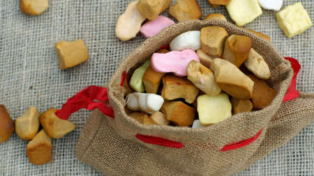 festiveness: Jute bag with ginger nuts and candies, typical Dutch treat for Sinterklaas on 5 decembe