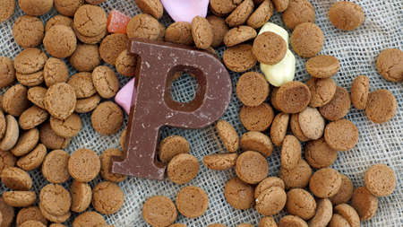 dutch typical: Pile of Dutch Pepernoten and chocolate, typical Dutch treat for Sinterklaas on 5 december