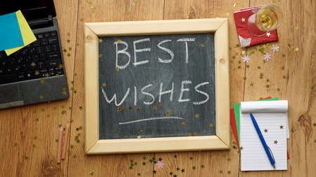 best wishes: Best wishes written on a chalkboard at the office