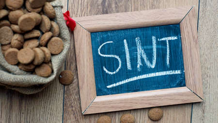 '5 december': Pile of Old Dutch Pepernoten and the word Sint written, typical Dutch treat for Sinterklaas on 5 december
