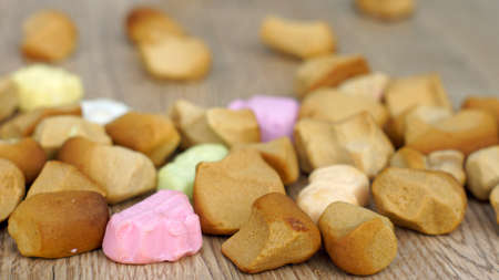 '5 december': Dutch old pepernoten on the floor, typical Dutch treat for Sinterklaas on 5 december Stock Photo