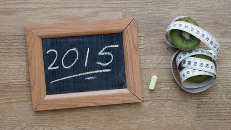 2015 written on a chalkboard next to a kiwi an inches