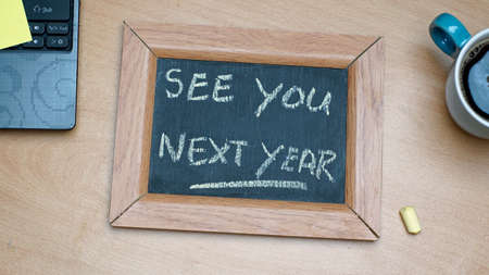 next year: See you next year written on a chalkboard at the office