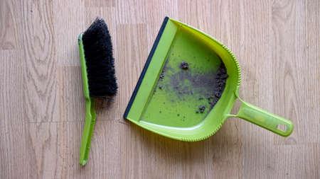 Dustpan and brush with dirt Reklamní fotografie