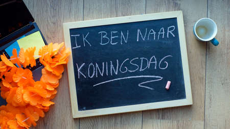 I am visiting kingsday in Dutch written on a chalkboard at the office