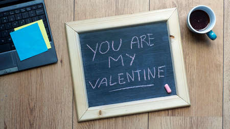 You are my valentine written on a chalkboard at the office photo