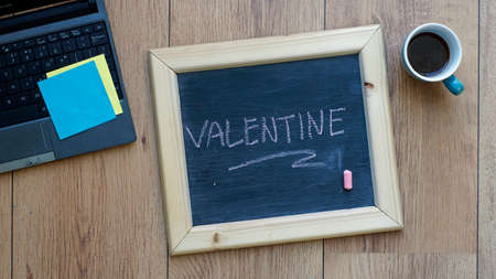 Valentine written on a chalkboard at the office photo