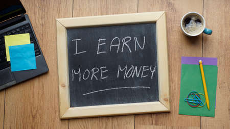 earn more: I earn more money written on a chalkboard at the office