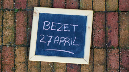occupy: Occupy on the 27th of April written in Dutch on the sidewalk for Kings day Stock Photo