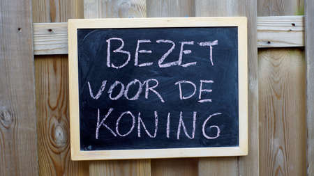 occupy: Occupy for the king written in Dutch on a chalkboard for the flea market of Kings day Stock Photo