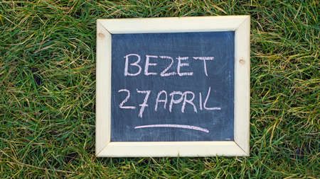 occupy: Occupy on the 27th of April written in Dutch on a chalkboard for the flea market of Kings day Stock Photo