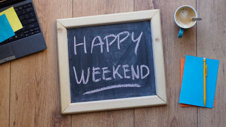 Happy weekend written on a chalkboard at the office
