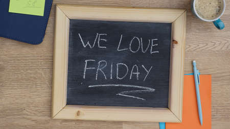 We love friday written on a chalkboard at the office photo