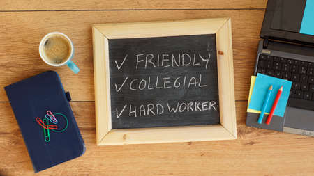 collegial: Friendly, collegial and a hard worker written on a chalkboard at the office