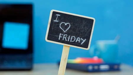 I love friday written on a chalkboard, in the background a office photo