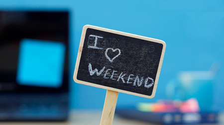I love weekend written on a chalkboard, in the background a office photo