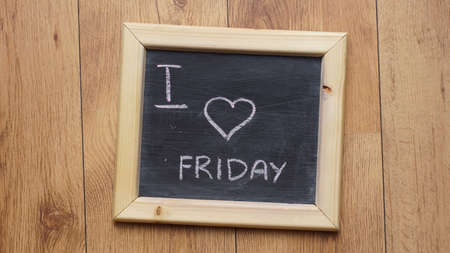 I love friday written on a chalkboardat the office photo