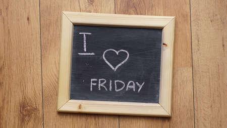 I love friday written on a chalkboardat the office photo