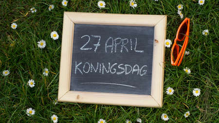 27th of April written on a chalkboard, Kingsday in the Netherlands Standard-Bild