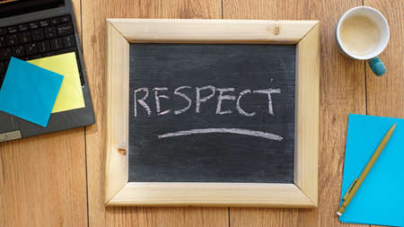 concluding: Respect written on a chalkboard at the office