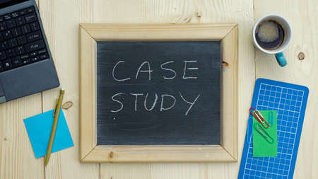 distinguished: Case study written on a chalkboard at the office