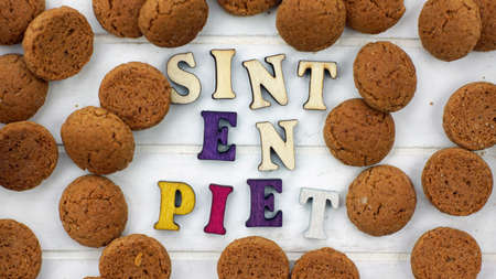 sint: Sint en Piet written with wooden letters for the Sinterklaas celebration on the 5th of December Stock Photo