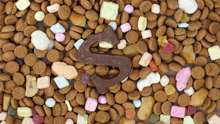 gingernuts: Ginger nuts  and the letter s for the Dutch Santa-Claus celebration for the 5th of December Stock Photo