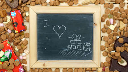 nicolaas: I love presents painted on a chalkboard between ginger nuts and candys for the Dutch Santa-Claus celebration of the 5th of December