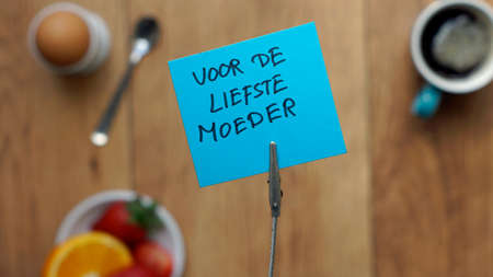 friendliness: For the sweetest mother written in Dutch on a memo between a breakfast for her