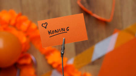 I love the King in Dutch written on a card at a table  with orange stuff for Kingsday