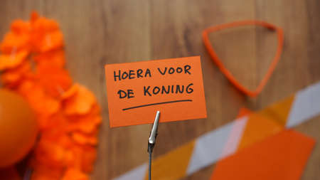 hurray: Hurray for the King in Dutch written on a memo at a table with orange stuff