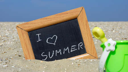 beach access: I love the summer written on a chalkboard in front of the sea