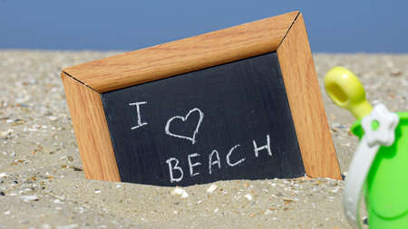 beach access: I love the beach written on a chalkboard in front of the sea