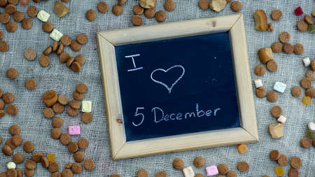 ginger nuts: I love the 5th of December in Dutch written on a chalkboard between ginger nuts and candys for the Dutch Santa-Claus Stock Photo