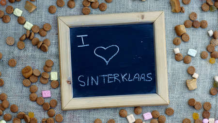 ginger nuts: I love Sinterklaas in Dutch written on a chalkboard between ginger nuts and candys for the Dutch Santa-Claus Stock Photo
